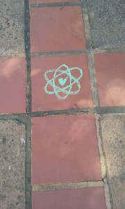 Atomic Green Love: Similar symbols decorated sidewalk in multiple locations